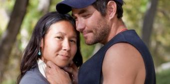 Indigenous-couple-hugging-outside